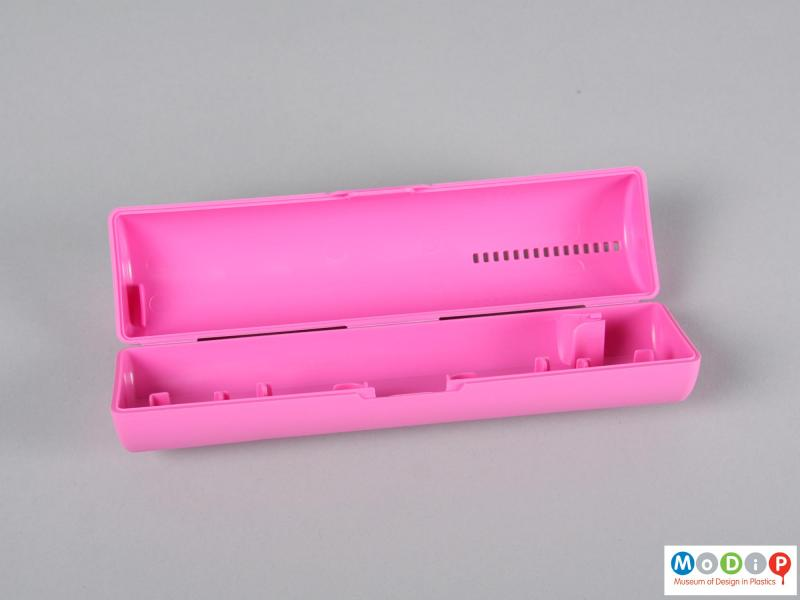 Front view of a toothbrush case showing the inside.