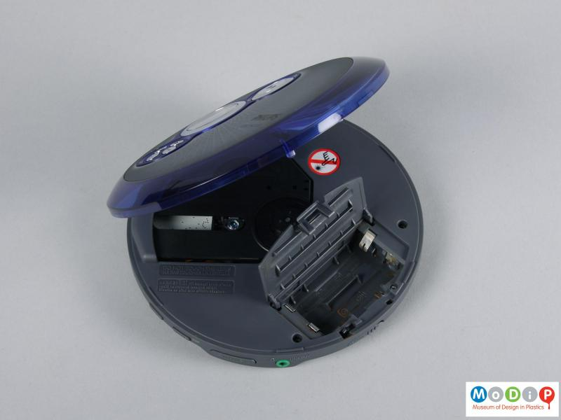 Top view of a CD player showing the battery compartment.