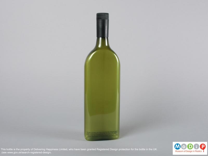 Rear view of a bottle showing the rectangular shape.