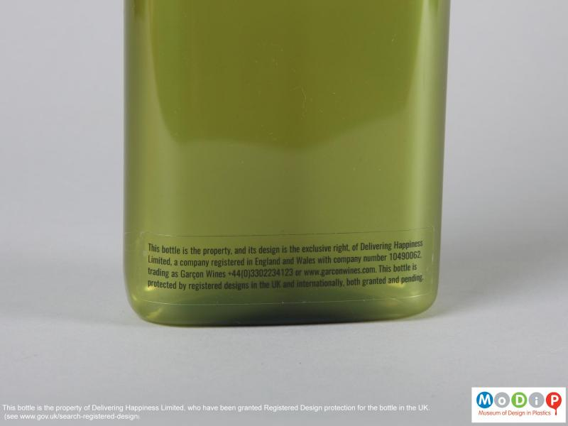 Close view of a bottle showing of the adhesive label.