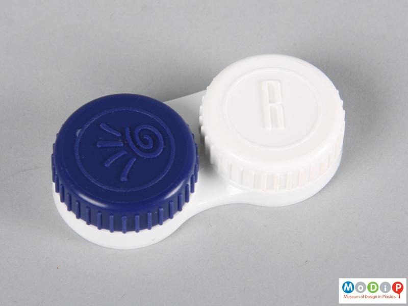 Top view of a pair of contact lenses showing the storage case.