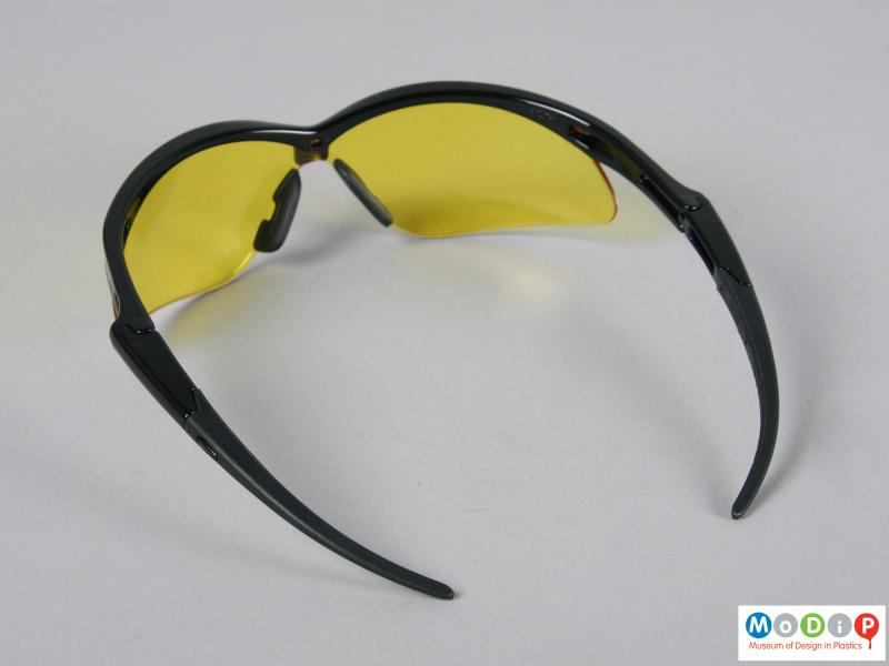Top view of a pair of glasses showing the long pointed arms.