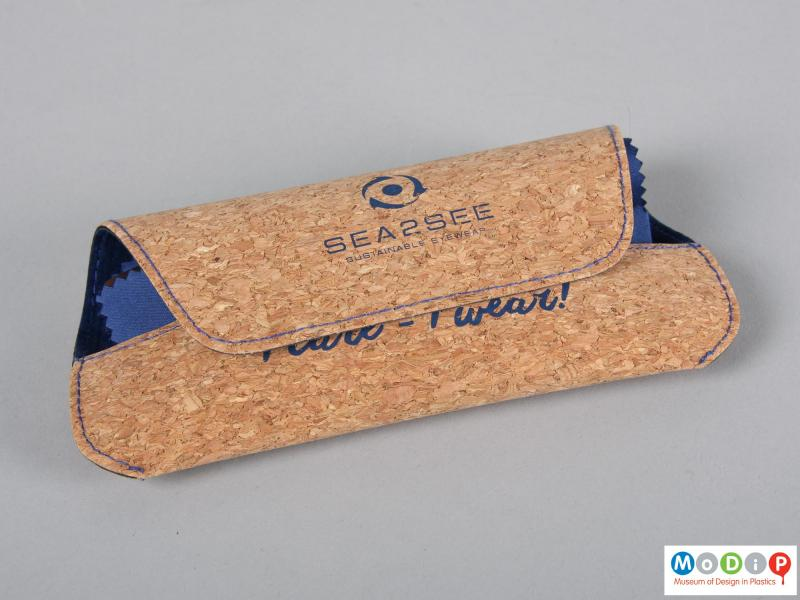 Front view of a pair of glasses showing them in a cork pouch.