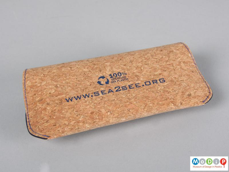 Rear view of a pair of glasses showing them in a cork pouch.