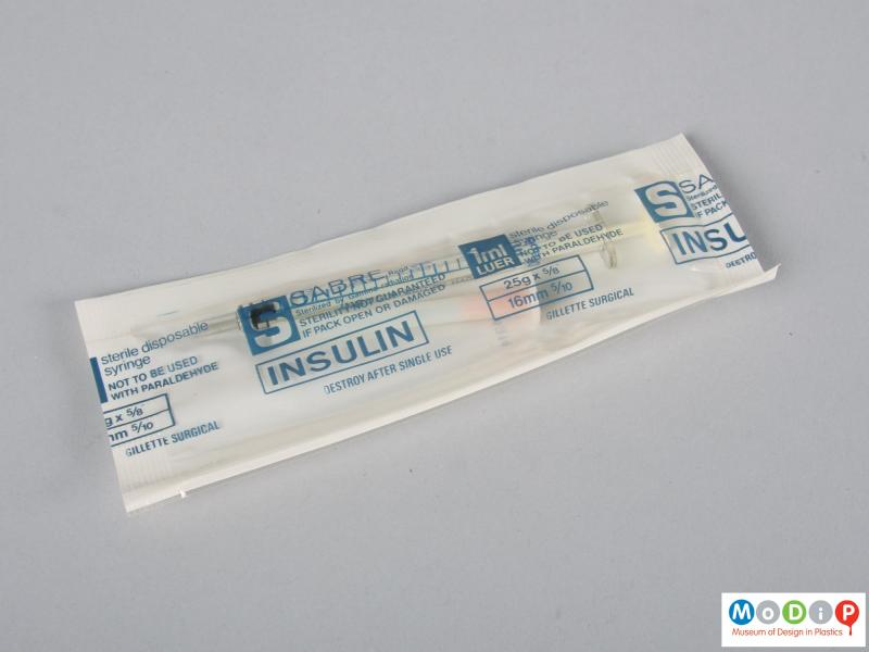 Front view of a syringe in sterile packaging.