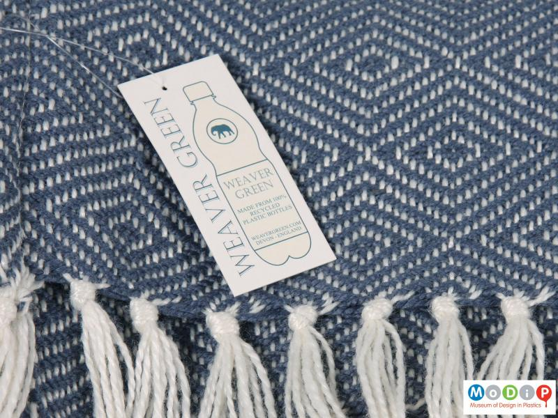 Close view of a blanket showing the swing tag.