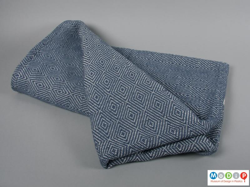 Side view of a blanket showing the woven pattern.