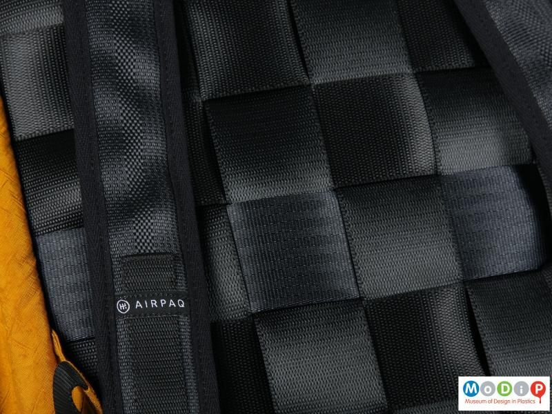 Close view of a backpack showing the woven webbing.