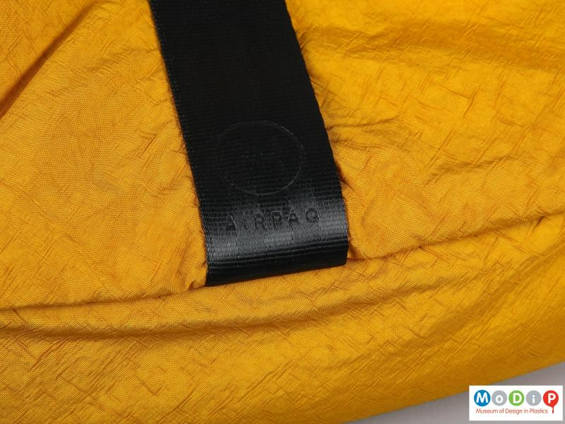 Close view of a backpack showing the logo.
