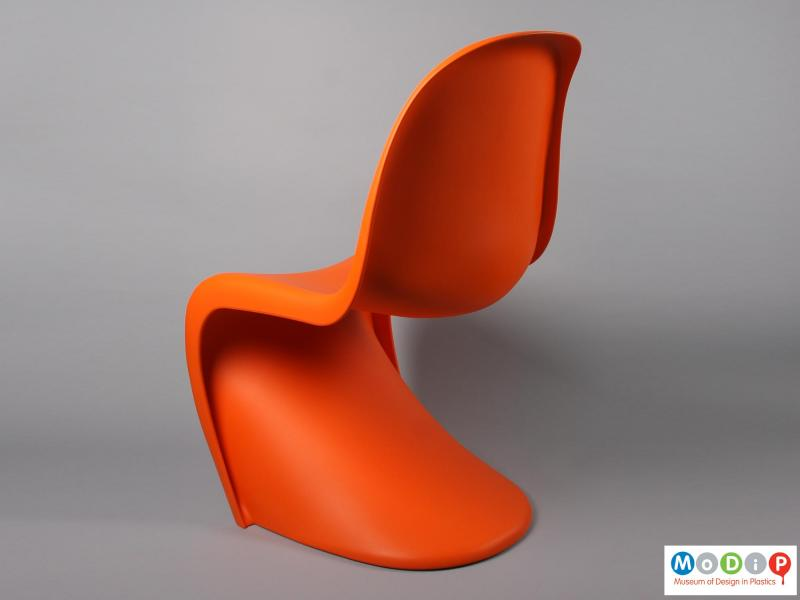 Side view of a chair showing the s shape.