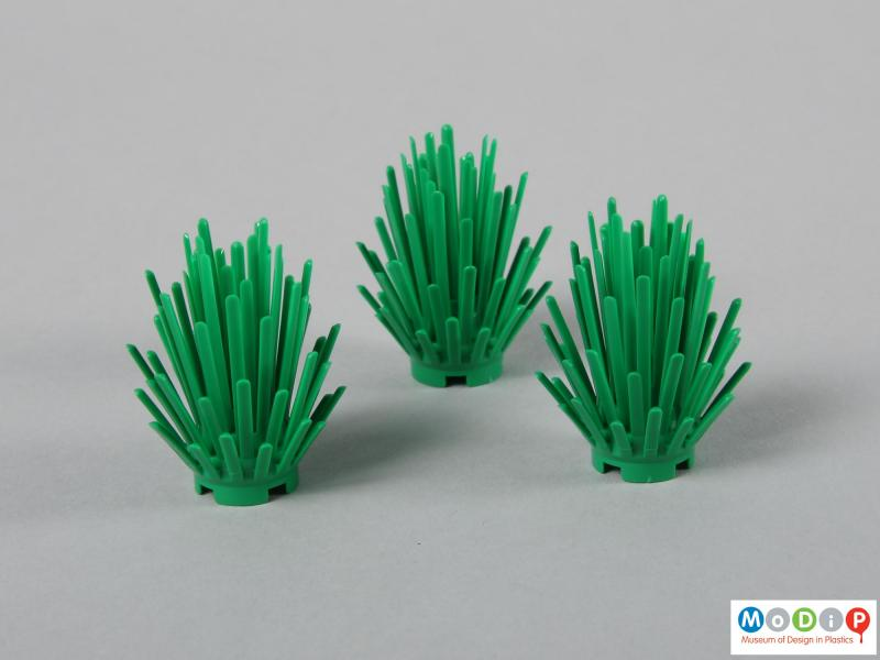 Side view of a Lego set showing the bushes.