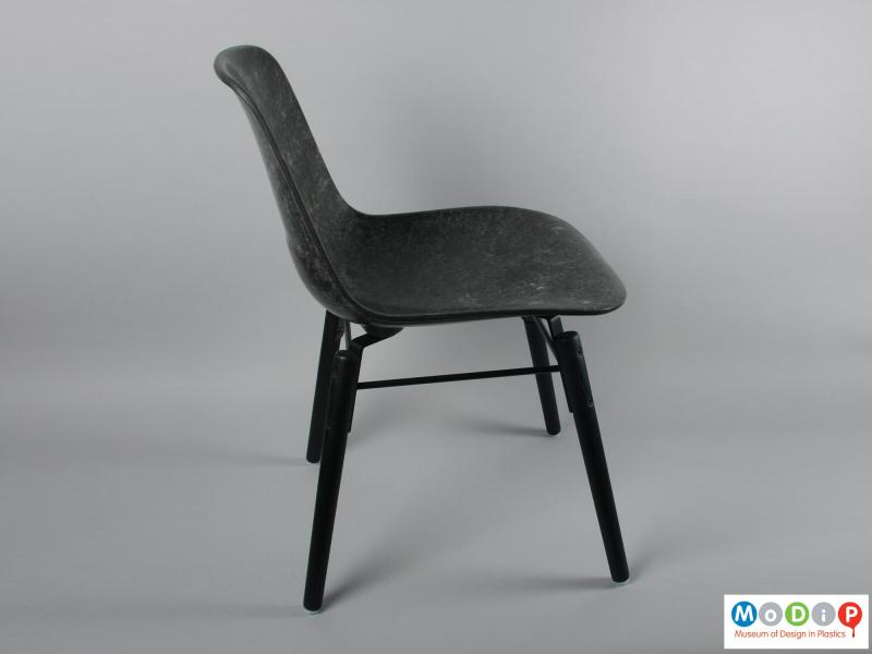 Side view of a chair showing the legs.