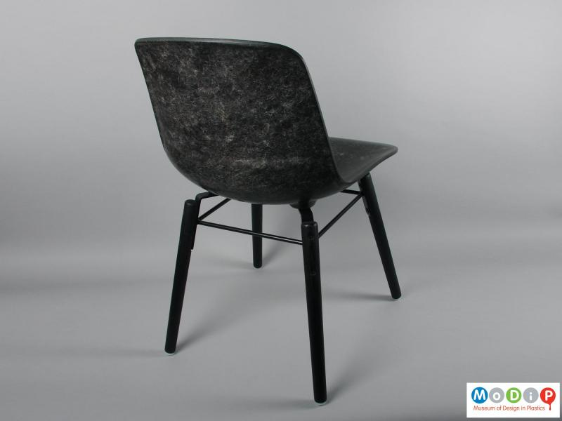 Rear view of a chair showing the legs.