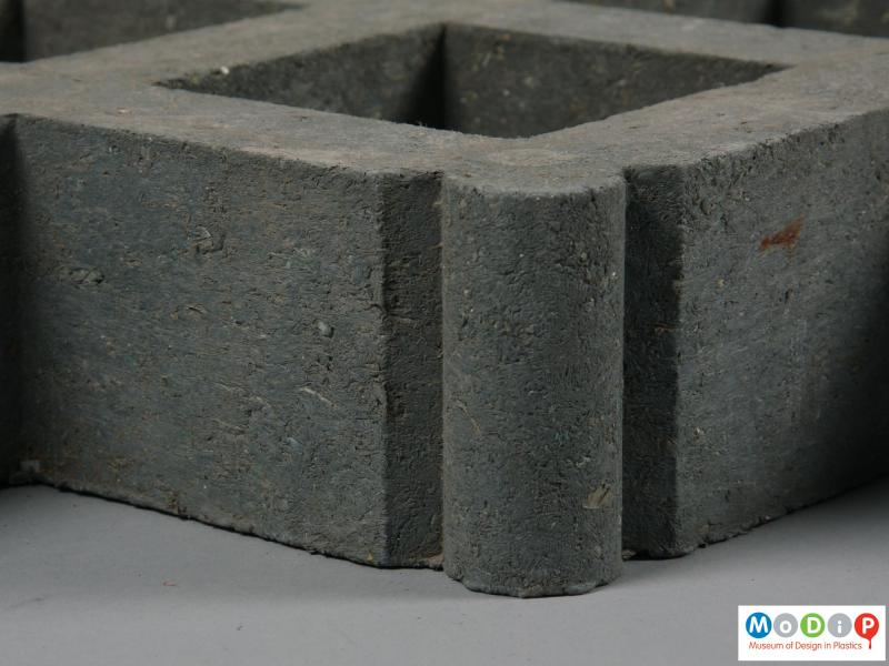 Close view of a paver showing the material.