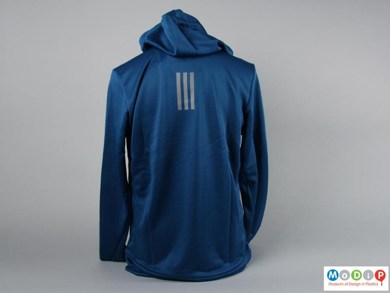 Rear view of a hoodie showing the reflective stripes.