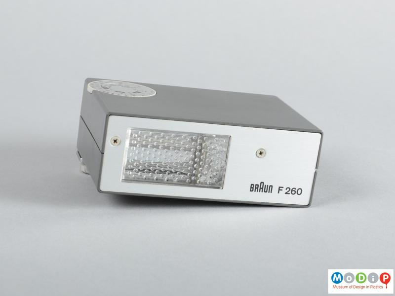 Front view of a flash unit showing the patterned bulb cover.