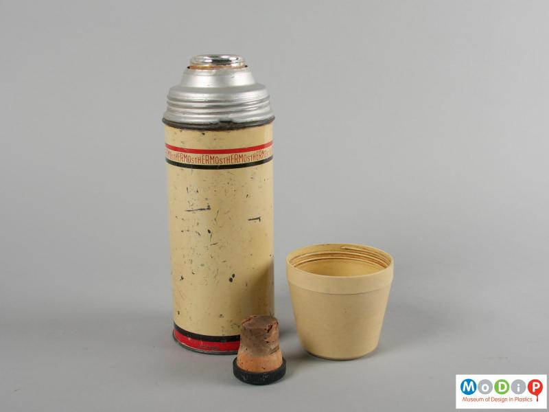 Side view of a flask showing the bung and cup.