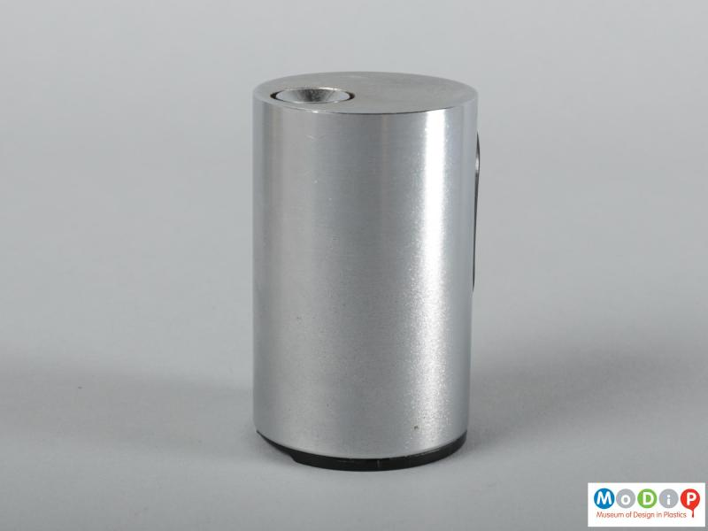 Side view of a lighter showing the smooth metal surface.