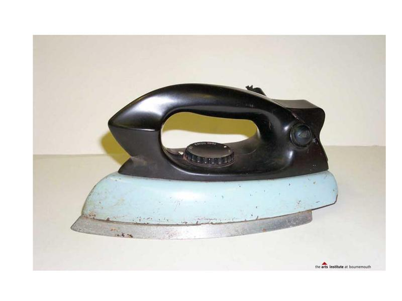 Side view of an iron showing the large black handle.