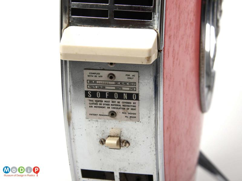 Close side view of a Sofono electric heater showing the registration panel and the handle on one side.