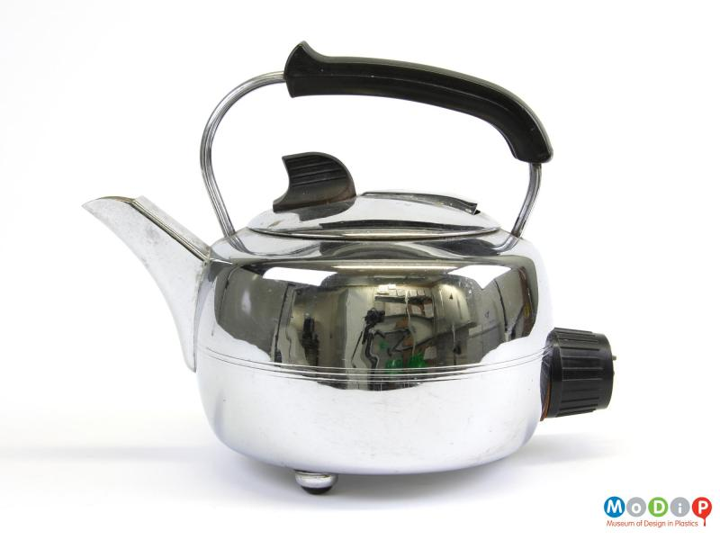 Side view of a Swan kettle showing the round body and curved handle.