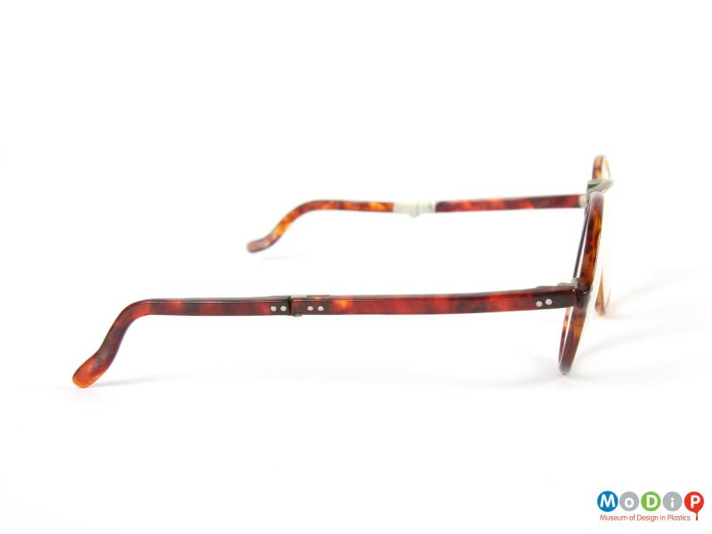 Side view of a pair of folding glasses showing the arm.