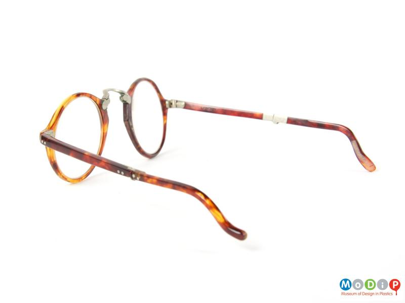 Side view of a pair of folding glasses showing arm.