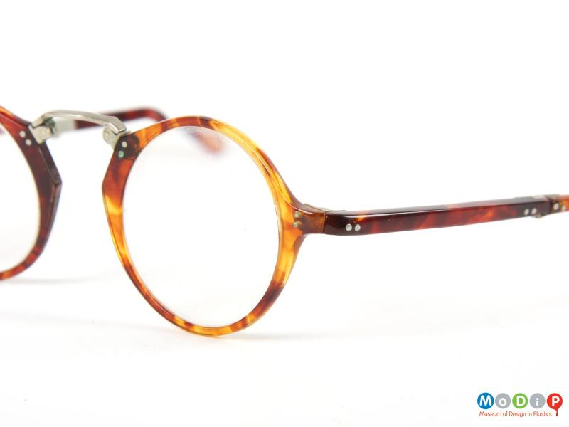 Close view of a pair of folding glasses showing the translucent nature of the material.