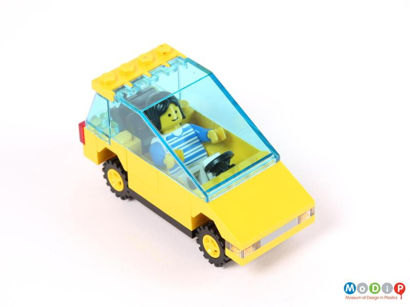 Top view of a toy car showing the figure in the driver's seat.