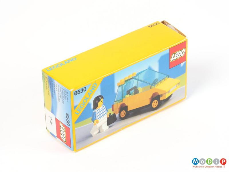 Side view of a toy car showing the packaging.