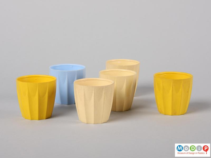 Side view of six nBware egg cups showing the distinct moulded ribbing down the side of the cups.