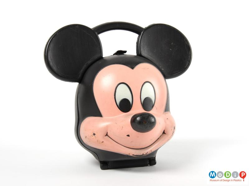Front view of a Mickey Mouse lunch box showing the face and ears.