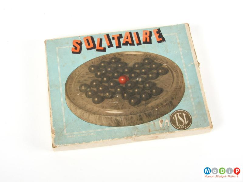 Top view of a solitaire game showing the packaging.