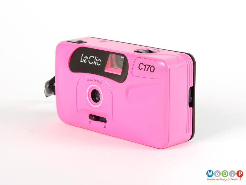 Side view of a camera showing the pink front case.