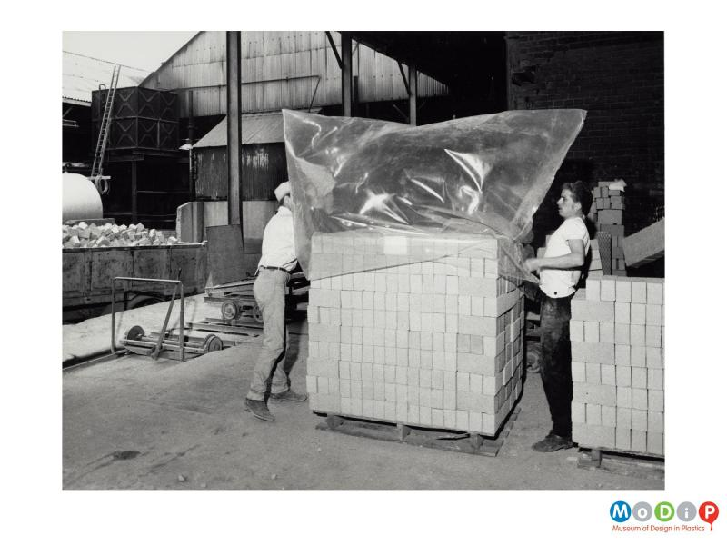 Scanned image showing a polythene bag covering a stack of bricks prior to being shrunk.
