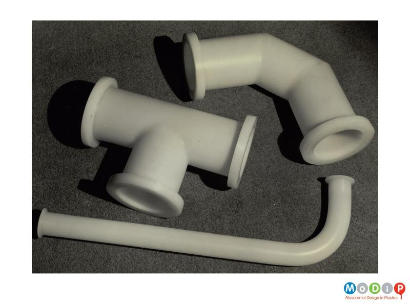 Scanned image showing three different pipe fittings.