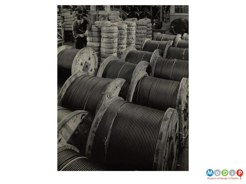 Scanned image showing reels of cable.