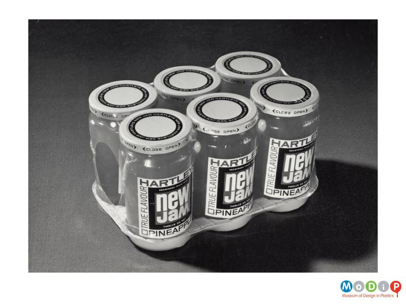 Scanned image showing six jam jars shirnk wrapped together.