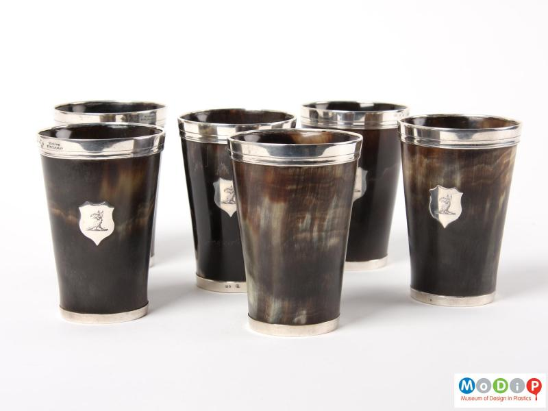 Side view of a set of beakers showing the silver mounts.