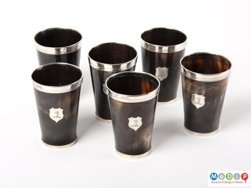 Top view of a set of beakers showing the silver mounts.