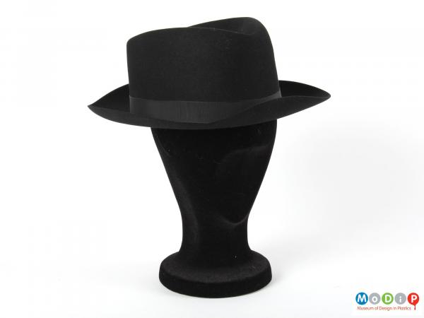 Front view of a hat showing the brim running around the whole hat.