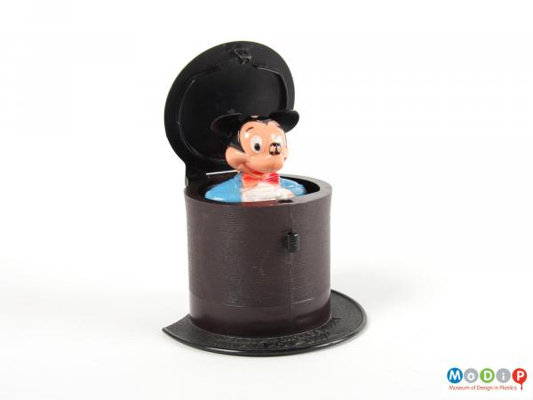 Front view of a pop up toy showing the lid open and the mouse up.