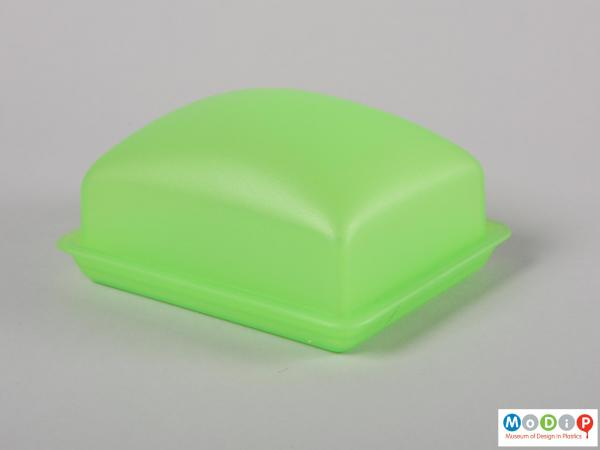 Side view of a butter dish showing the smooth shape.