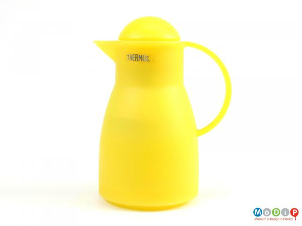 Side view of a Thermos jug showing the smooth lines and dome stopper.
