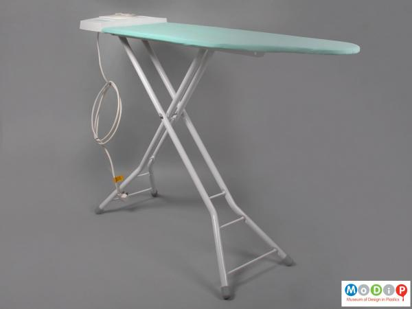 Side view of a Thormogem Ironing System showing the ironing board with the x frame at the base.