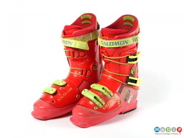 Front view of a pair of ski boots showing the solid structure.