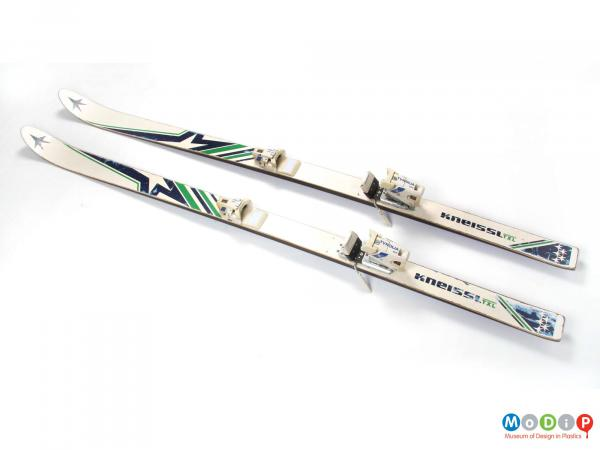 Top view of a pair of Kneissl skis showing the full length of the skis.