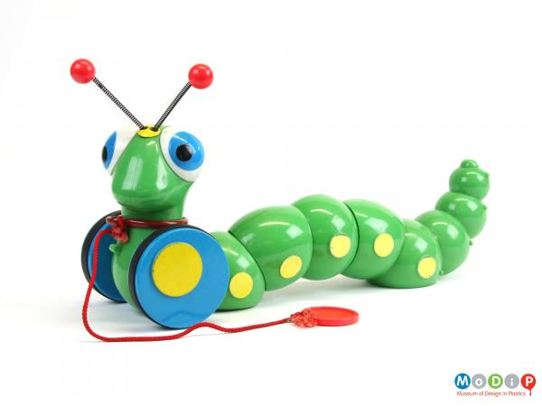 Side view of a pull-along toy showing the sectional body.
