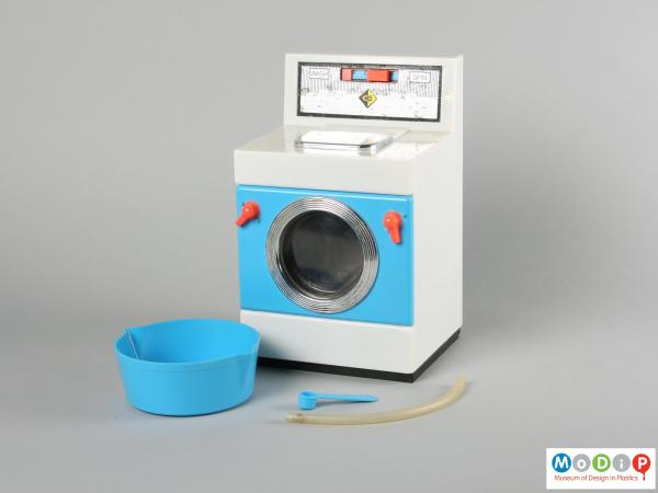 Front view of a Casdon toy washing machine showing the washing machine, measure, bowl and tube.