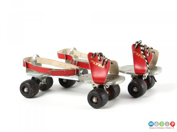 Side view of a pair of roller skates showing the toe and ankle straps.